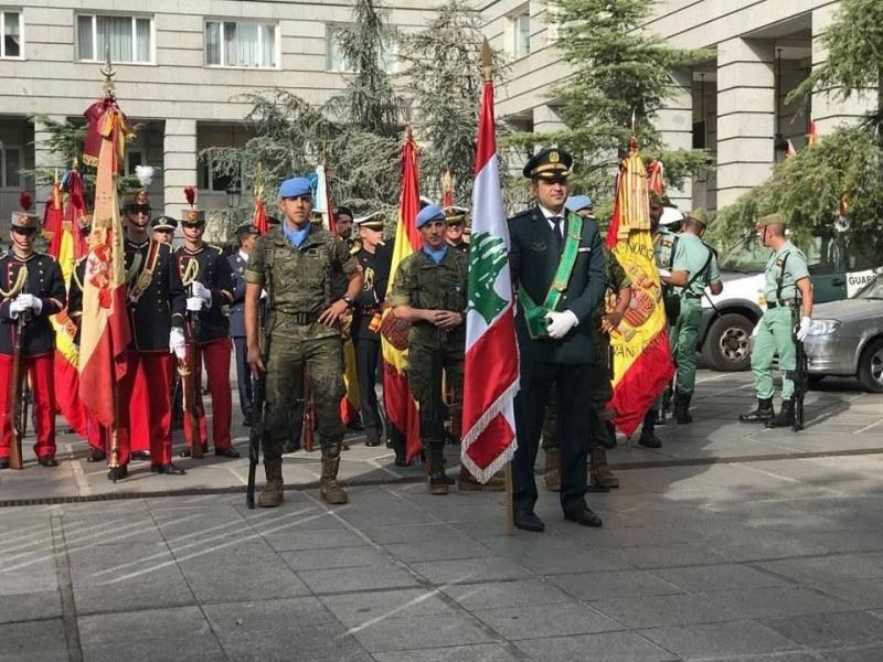 Spanish soldiers hold a Lebanese flag during Spain s National Day in Madrid, Thursday, Oct. 12, 2017